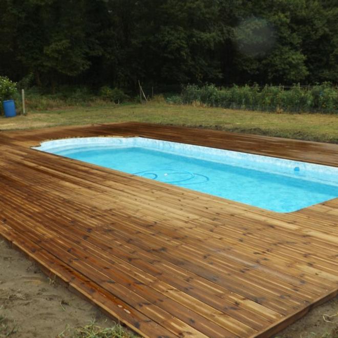 Terrasse en pin traité brun sur Buglose